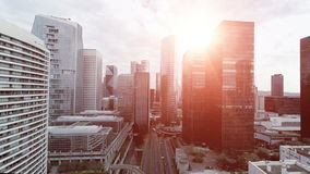 Skyscrapers at sunset sky. Aerial view of modern cityscape buildings district stock footage