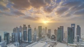 Skyscrapers at sunset timelapse in the skyline of commercial center of Doha, the capital Qatar