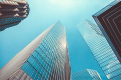 Skyscrapers with blue sky above them - symbol of business success. Skyscrapers - symbol of business success with blue sky above them Stock Photos