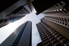 Skyscrapers tunnel of tall office towers surrounding the claustrophobic diminishing perspective view. royalty free stock photos