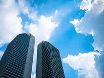 Skyscrapers. Under the blue sky  and beautiful clouds Stock Images