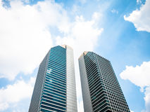 Skyscrapers. Under the blue sky  and beautiful clouds Stock Photos