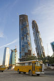 Skyscrapers under construction in dubai. Bus waiting to collect workers in a construction site in dubai Stock Image