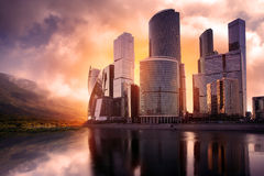 Skyscrapers utopia new modern city. Reflection in water Stock Image