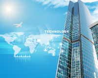 Skyscrapers with world map and clouds. On blue sky background Stock Photo