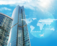 Skyscrapers with world map and clouds. On blue sky background Stock Photos