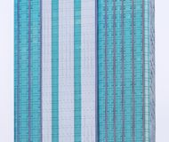 Skyscrapper with blue windows close-up Royalty Free Stock Photos