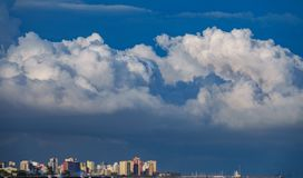 Skyscrappers near sea with stormy clouds as hat. Skyscrappers near sea with stormy clouds hat over them royalty free stock photography