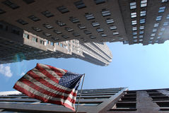 Skyscrappers in NY. Skyscrappers in Mahattan and american flag Royalty Free Stock Photography