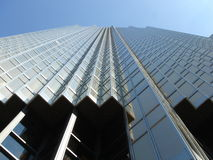 Skyscryper with many angles. Modern skyscraper in Toronto,Canada, with many angles viewed from down with windows in glass and many angles by beautiful weather stock images