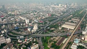 Skyskraber top view of Bangkok city transport interchange roads and high ways stock video