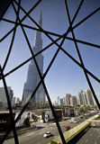 The skyskraper Burj Khalifa in Dubai. Behind a grid, the Burj Khalifa, at moment the highest skyscraper in the world. It is located in Dubai, Emirates Arab royalty free stock photography