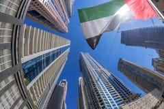 Skyskrapor mot solsken vid fisheye i Dubai, Förenade Arabemiraten Royaltyfri Fotografi