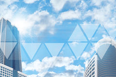Skyskrapor och himmel med genomskinliga trianglar Fotografering för Bildbyråer
