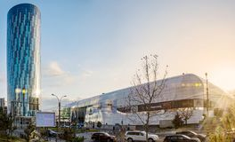Skytower and shopping mall in Bucharest. Romania at sunset Royalty Free Stock Photos