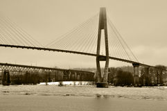 Skytrain Bridge across Fraser River floating ice in the winter Stock Photo