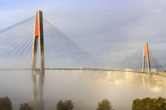 Skytrain bridge and a city in a foggy morning Royalty Free Stock Image