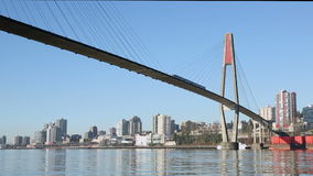 Skytrain Bridge, New Westminster Cityscape. A commuter rail bridge crosses the Fraser River into New Westminster. British Columbia, Canada stock footage
