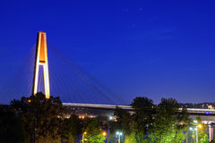 Skytrain bridge with skytrain light trails at blue hour stock photo