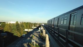 Skytrain commuter rail system at YVR airport station stock video footage
