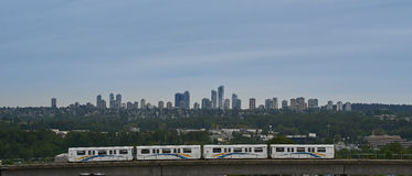 Skytrain running in front a city Stock Image