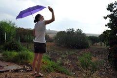 Skytt - det första regnet Royaltyfria Foton