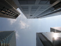 Skywards between the skyscrapers. Looking up towards the sky between huge skyscrapers in Hong Kong's business district royalty free stock image