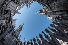 Skywards view to the ornate towers of the Duomo Cathedral in Mil Stock Image