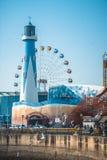 Skywheel y faro imagen de archivo libre de regalías