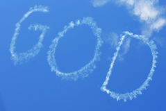 Skywritten God. The word GOD in sky from skywriting Stock Image