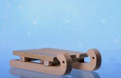 Släde på snöig bakgrund Royaltyfria Foton