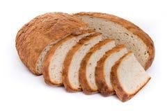 Släntra av vitt bröd, klippt och skivat Royaltyfria Foton