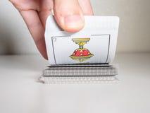 Släpiga kort för hand Begrepp royaltyfria foton