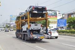 Släplastbil, bilar, lastbilar Arkivfoto