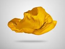 Slät elegant guld- torkduk på grå bakgrund Fotografering för Bildbyråer