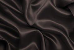 Släta elegant brun silke- eller satängtextur som abstrakt backgroun Fotografering för Bildbyråer