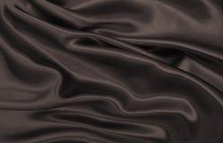 Släta elegant brun silke- eller satängtextur som abstrakt backgroun Royaltyfria Foton