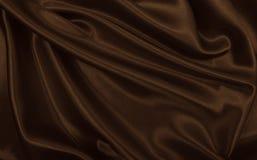 Släta elegant brun silke- eller satängtextur som abstrakt backgroun Arkivbild