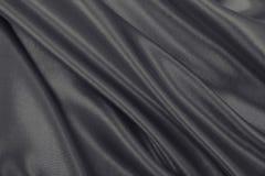 Släta elegant brun silke- eller satängtextur som abstrakt backgroun Royaltyfri Fotografi