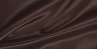 Släta elegant brun silke- eller satängtextur som abstrakt backgroun Arkivfoton