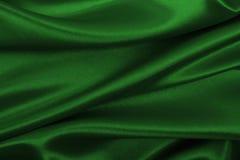 Släta elegant grön lyxig torkduketextur för silke eller för satäng som abstr Royaltyfri Foto