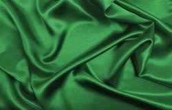 Släta elegant grön lyxig torkduketextur för silke eller för satäng som abstr Royaltyfria Foton