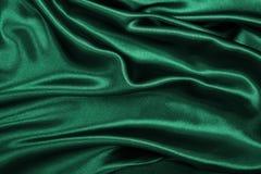 Släta elegant grön lyxig torkduketextur för silke eller för satäng som abstr Royaltyfri Fotografi
