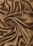 Släta elegant guld- silke- eller satängtextur som abstrakt backgrou Royaltyfri Bild