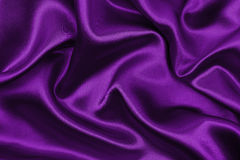 Släta elegant lila lyxig torkduketextur för silke eller för satäng som abstr Arkivfoton
