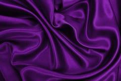 Släta elegant lila lyxig torkduketextur för silke eller för satäng som abstr Royaltyfri Bild