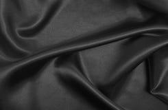 Släta elegant mörk grå silke- eller satängtextur som abstrakt backg Royaltyfri Fotografi