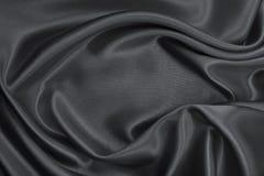 Släta elegant mörk grå silke- eller satängtextur som abstrakt backg Royaltyfria Foton