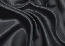 Släta elegant mörk grå silke- eller satängtextur som abstrakt backg Royaltyfri Foto