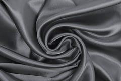 Släta elegant mörk grå silke- eller satängtextur som abstrakt backg Royaltyfri Bild